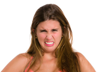Disgunting and unpleasant. Hispanic young woman. Expression seri
