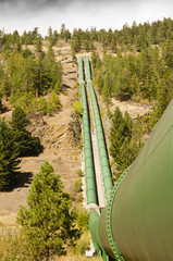 Penstock curving down mountainside to Bridge River power plant at Shalath, BC, Canada