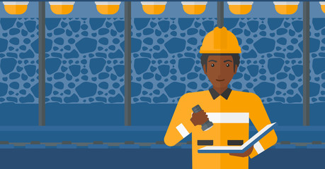 Miner checking documents.
