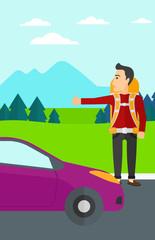 Young man hitchhiking.