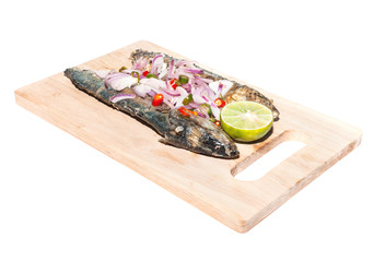 Salted fish on wooden plate isolated
