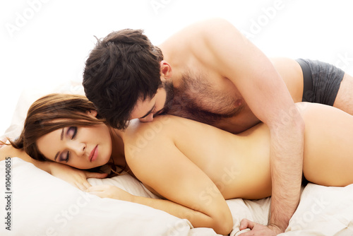 nude young couples in bed