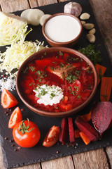Ukrainian soup and ingredients on a slate board closeup. vertical
