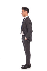 side view of a young business man standing in line