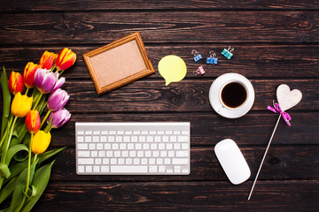 Tulips, keyboard and office supplies
