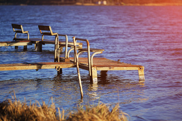 empty old footbridges with benches on a lake