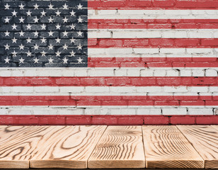United States of America flag painted on brick wall with wooden