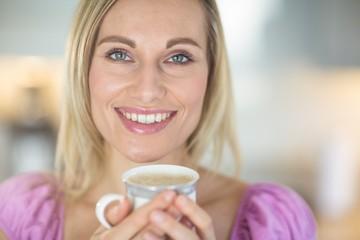 Pretty blonde woman having coffee