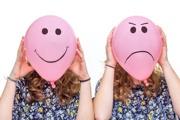 Two girls holding pink balloons with facial expressions for head