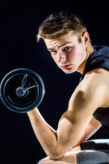 Handsome Teen boy with dumbbell.