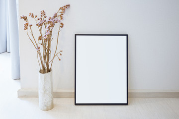 Mock up photo frame on floor Home interior decoration with flower