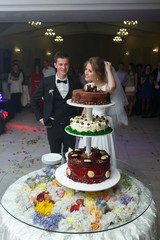 happy just married couple cut their beautiful delicious tasty un