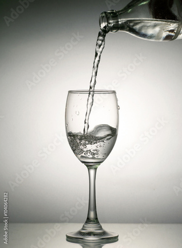 Drinking Water Pouring In Wine Glass Stock Photo And