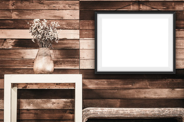 mock up poster frame  on wooden wall, hipster interior backgroun