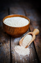 White quinoa on rustic wooden background