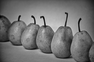 ripe pears on a white background