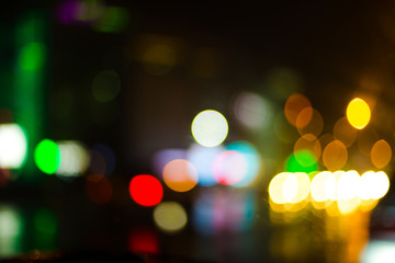 Colorful defocused bokeh lights background. City glare abstract background.
