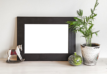 Frame mockup with toy horse