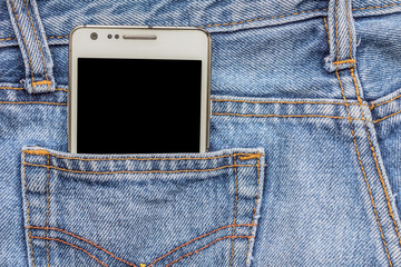 White phone in jeans pocket