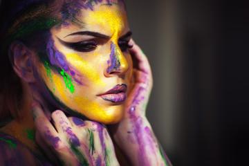 Woman body art on a grey background
