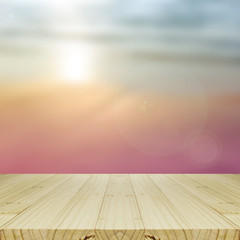 Wood Table and Blurred Sunrise Background.