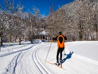 Athlete on a cross-country ski run on a cross-country ski run