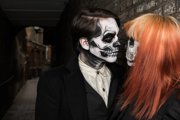 Evil day of the dead undead couple in alley street