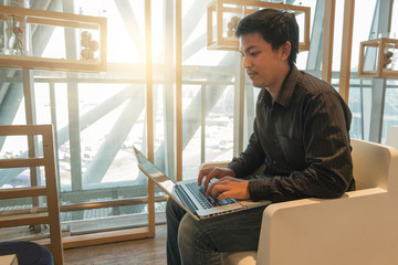 Man use laptop in airport lounge