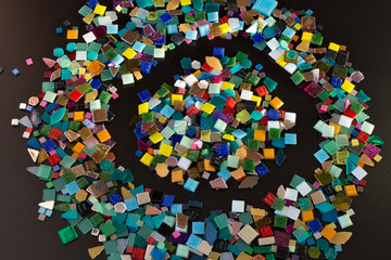 Pieces of mosaic on black background