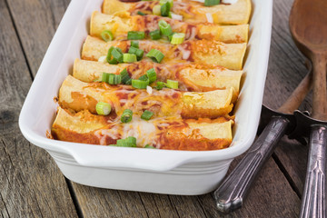 Casserole dish with mexican food - beef enchiladas.