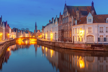Scenic night cityscape with views of Spiegelrei and Jan van Eyckplein in Bruges, Belgium