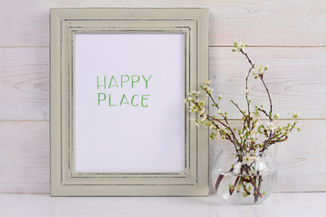 Home and family  and happiness concept. Happy place poster in frame rustic , shabby chic, vintage style. Scandinavian style home interior decoration.