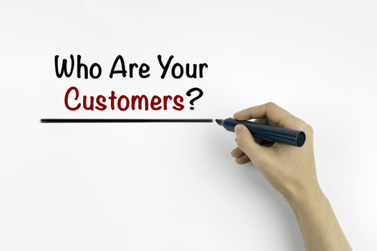 Hand with marker writing: Who are your customers?
