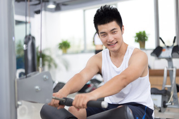 young man working out in modern gym