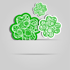 Clover leaves with an abstract pattern. Festive card. Day of Patrick. The place for the text.