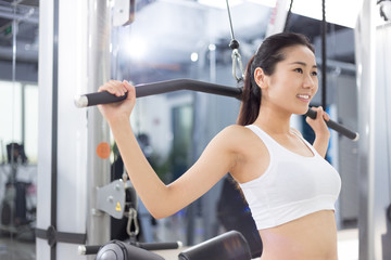 beautiful girl working out in modern gym