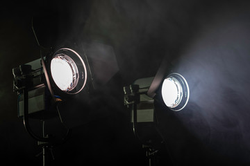 Two lights in smoke. Two studio lights shining through the smoke from smoke machine.