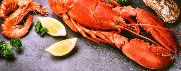 Fine selection of crustacean. Steamed lobster with lemon