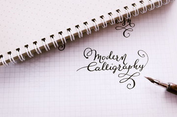 Hand drawn lettering background. Lettering brush calligraphy on paper
