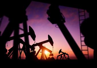 Oil Pumps at Dusk. Oil pumps producing oil at dusk.
