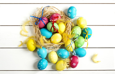 colored Easter eggs on a white table