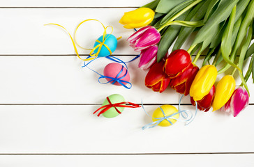 tulips and Easter eggs not white table