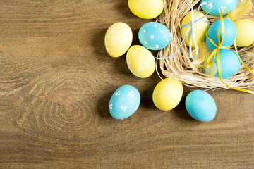 colored Easter eggs on a wooden table
