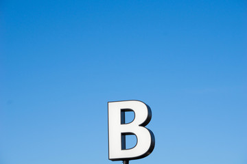 letter B and blue sky