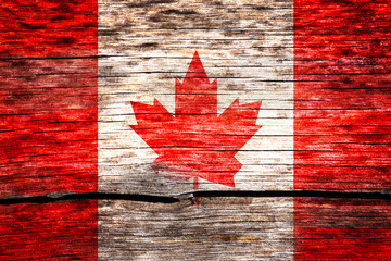 Canada flag painted on the old cracked wood with worn-out paint. Grunge look.