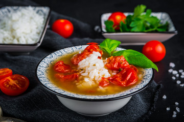 Fresh tomato soup with rice and cherry tomatoes