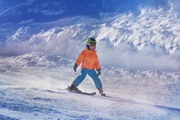 Little boy ski down the mountain by himself