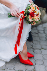 Beatiful bride with boquet in the hend