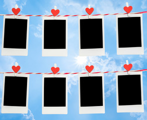 8 Blank instant photo and red clip paper heart hanging on the clothesline with blue sky nature and cloud background..Designer concept.
