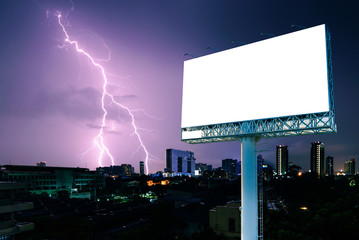 Blank billboard for advertising with strike of lightning into building.